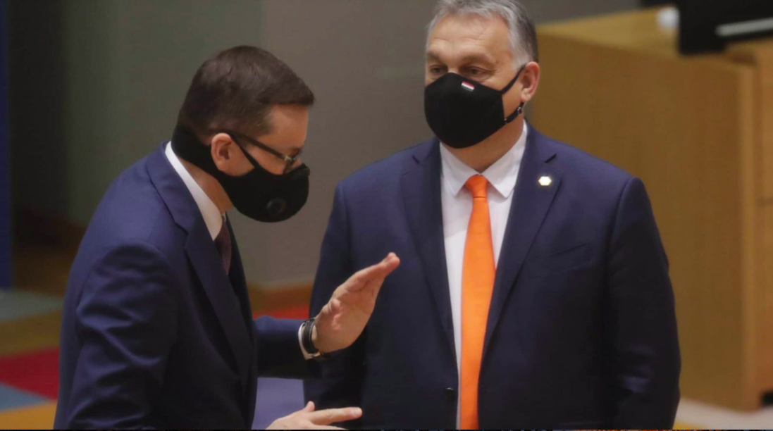 Poland's Prime Minister Mateusz Morawiecki (L) and Hungarian Prime Minister Viktor Orban (R) chat at the start of a two days face-to-face EU summit, in Brussels, Belgium, 10 December 2020